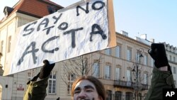 A protester shouts slogans during a demonstration against the Anti-Counterfeiting Trade Agreement (ACTA), in front of the Presidential Palace in Warsaw, Poland, February 11, 2012.