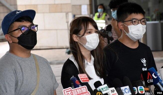 资料照:前香港众志秘书长黄之锋黃(右)、前成員周庭(中)、前主席林朗彥