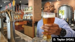 Airport Craft Brewers barman Oscar Sentane prepares to serve one of Marali's blonde lagers at the O.R. Tambo airport in Johannesburg, South Africa.