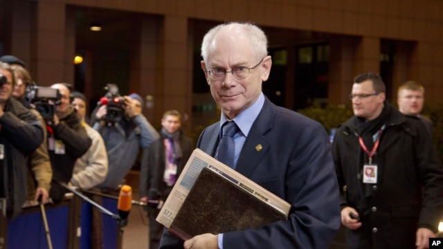 European Council President Herman Van Rompuy, center, arrives for an EU summit in Brussels on Friday, Nov. 23, 2012.