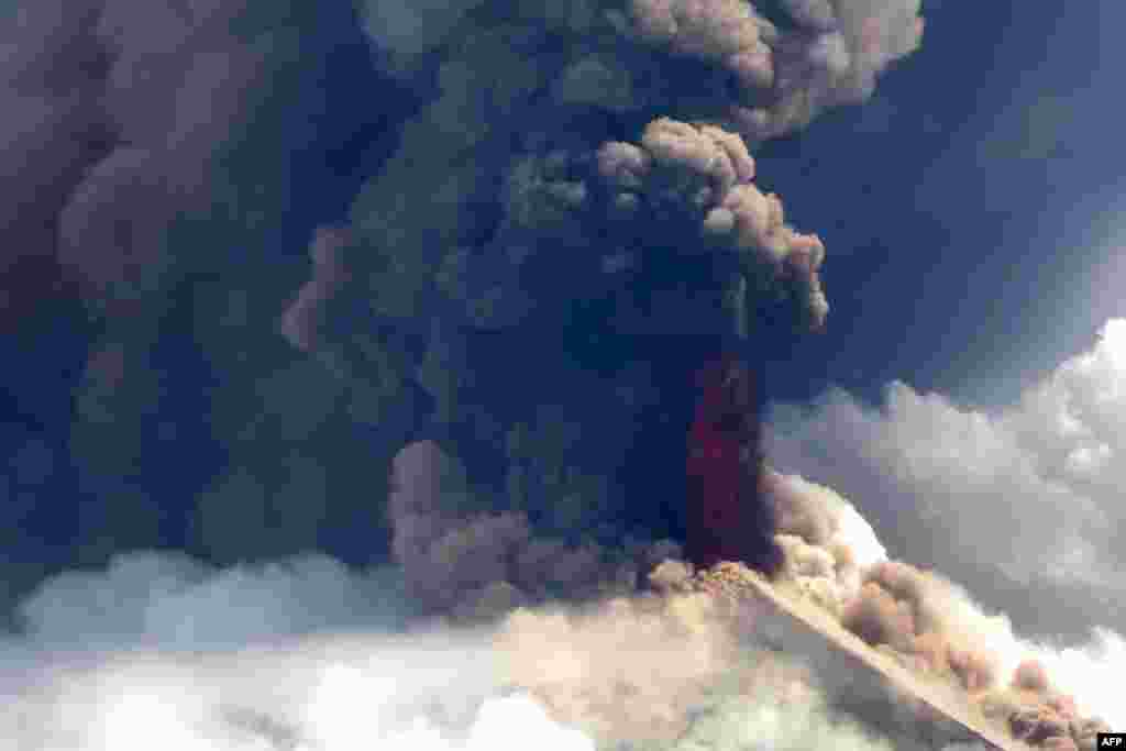 This image from Niugini Helicopters shows Papua New Guinea's Mount Ulawun volcano shooting out lava.