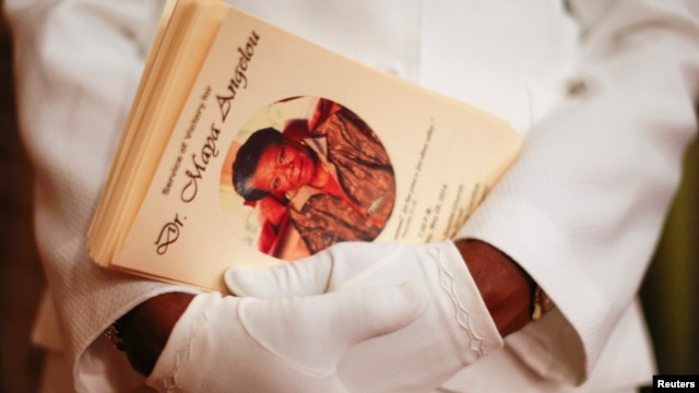 FILE - Delores Edwards holds copies of a program during a memorial service for American author and poet Maya Angelou at Mount Zion Baptist Church in Winston-Salem, North Carolina, May 29, 2014.