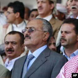 Yemen's President Ali Abdullah Saleh (C) attends a rally held by pro-government supporters in Sanaa, May 13, 2011