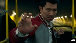 This image released by Marvel Studios shows Simu Liu in a scene from 'Shang-Chi and the Legend of the Ten Rings.' (Marvel Studios via AP)
