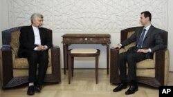7일 사에드 잘릴리 이란 국가안보 최고위원회 위원장(왼쪽)과 만난 바샤르 알 아사드 시리아 대통령.