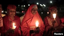 Bring Back Our Girls campaigners gather at a candlelight ceremony in Abuja marking the 500th day since the abduction of girls in Chibok, Nigeria, Aug. 27, 2015.
