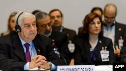 Ngoại trưởng Syria Walid Muallem (trái) và đoàn đại biểu tham gia cuộc đàm phán hòa bình Geneva II, ngày 22/1/2014.