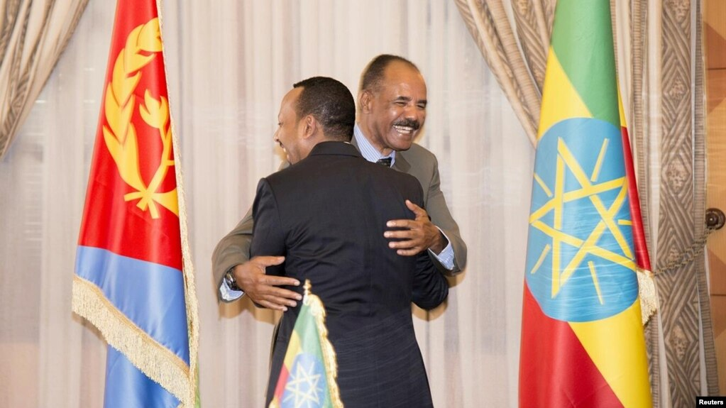 Ethiopian Prime Minister Abiy Ahmed and Eritrean President Isaias Afwerk embrace at the declaration signing in Asmara, Eritrea, July 9, 2018, in this photo obtained from social media. (Ghideon Musa Aron Visafric)