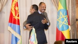 Ethiopian Prime Minister Abiy Ahmed and Eritrean President Isaias Afwerki embrace at the declaration signing in Asmara, Eritrea, July 9, 2018, in this photo obtained from social media. (Ghideon Musa Aron Visafric/via Reuters)