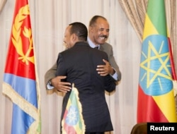 FILE - Ethiopian Prime Minister Abiy Ahmed and Eritrean President Isaias Afwerki embrace at a peace declaration signing in Asmara, Eritrea, July 9, 2018, in this photo obtained from social media. (Ghideon Musa Aron Visafric/via Reuters)