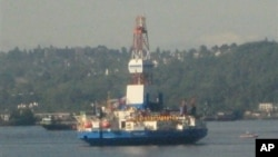 Ships such as Shell's Kulluk and Noble Discoverer bring oil drilling equipment to Alaska via Seattle's Elliott Bay, Washington state, June 27, 2012.