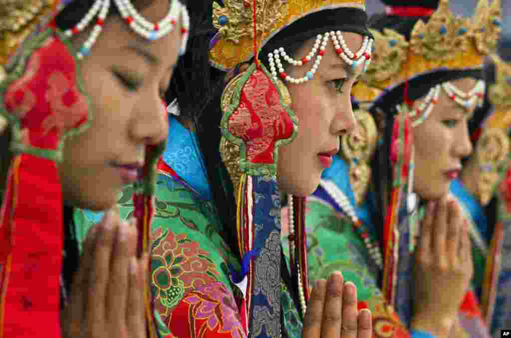 Tibetan artists in traditional costumes perform opera at the Tibetan Institute of Performing Arts in Dharamsala, India.