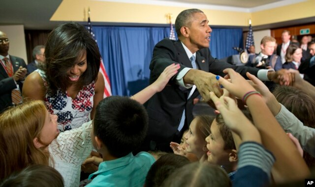 President Barack Obama and first lady Michelle Obama greet children and families of U.S. embassy personnel during an event at the Melia Habana Hotel in Havana, Cuba, March 20, 2016.