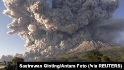 Mount Sinabung volcano erupts as seen from Kuta Rakyat village in Karo, North Sumatra Province, Indonesia March 2, 2021, in this photo taken by Antara Foto. Antara Foto/Sastrawan Ginting/via Reuters
