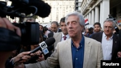 Uruguay's elected President Tabare Vazquez speaks to the media after arriving to participate in a ceremony where President Mujica will receive the Uruguayan flag on the last working day of his term in Montevideo, Feb. 27, 2015.