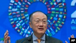Global Finance: World Bank President Jim Yong Kim gesture while speaking at a news conference during the World Bank/IMF Annual Meetings at IMF headquarters in Washington, Thursday, Oct. 6, 2016.