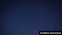 """A """"shooting star"""" is seen during the 2012 Quadrantid meteor shower. (<a href=""""http://www.flickr.com/photos/dshortey/"""">Flickr</a>)"""