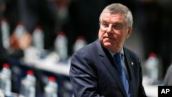 IOC President Thomas Bach waits for the beginning of the extraordinary FIFA congress in Zurich, Switzerland, Feb. 26, 2016. In a major change in the handling of positive drug tests at the Olympics, the IOC is set to remove itself from the process.