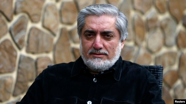 Afghan presidential candidate Abdullah Abdullah speaks during an interview in Kabul, April 20, 2014.
