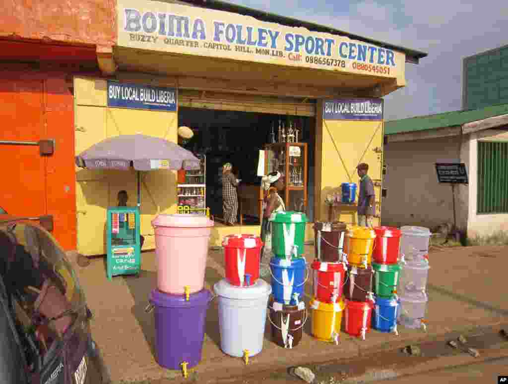 According to local reports, the sale of water buckets has increased dramatically because they are used by Liberians to wash their hands with disinfectantto prevent the spread of the deadly Ebola virus, Monrovia, Liberia, Aug. 4, 2014.