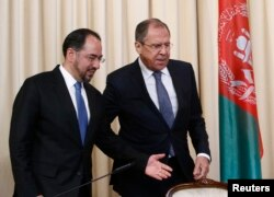 FILE - Russian Foreign Minister Sergei Lavrov and his Afghan counterpart Salahuddin Rabbani arrive for a joint news conference following their meeting in Moscow, Russia, Feb. 7, 2017.