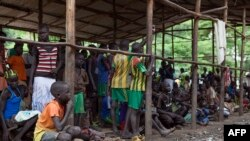 Children displaced by the fighting in South Sudan wait to be registered at a refugee camp in Ethiopia.