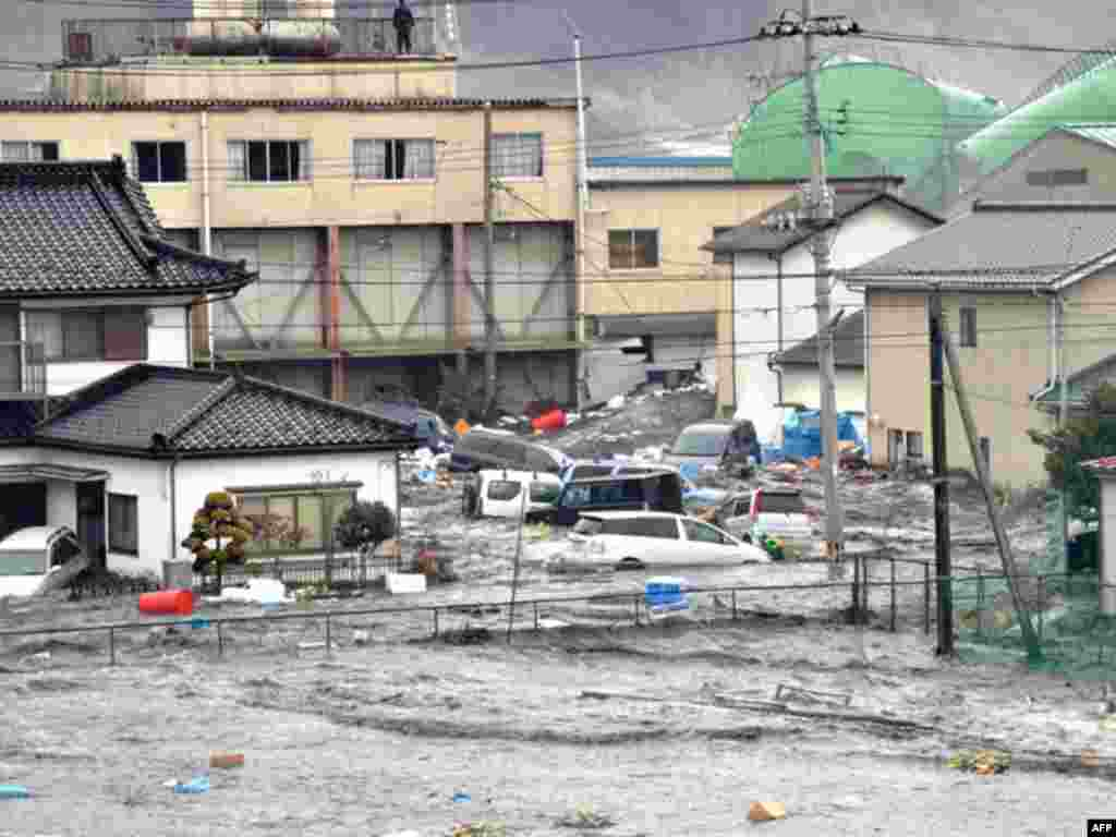 Streets are flooded after a tsunami and earthquake in Kesennuma city, Miyagi Prefecture, March 11, 2011. The biggest earthquake to hit Japan since records began 140 years ago struck the northeast coast on Friday, triggering a 10-metre tsunami that swept a