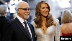 FILE - Singer Celine Dion and her husband Rene Angelil arrive at the 83rd Academy Awards at the 83rd Academy Awards in Hollywood, California, Feb. 27, 2011.