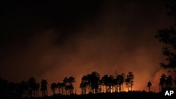 A wildfire burns near Los Alamos, New Mexico, June 28, 2011.