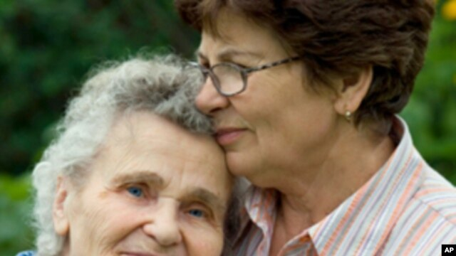 Alzheimer's patient and caregiver.