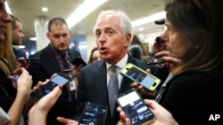 Sen. Bob Corker, R-Tenn., speaks to reporters while heading to vote on budget amendments, Oct. 19, 2017, in Washington.