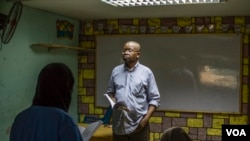 Jean Pie, teaching his class at the African Hope School, September 14, 2017.
