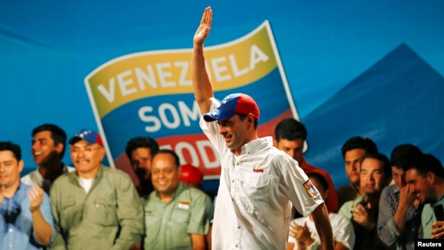 Venezuela's opposition leader and presidential candidate Henrique Capriles at campaign rally in Caracas, April 1, 2013