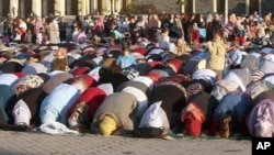 In this 2008 file photo, Albanian Muslims pray to mark the end of the fasting month of Ramadan. Turkey is planning to build a mosque for Albanians in Tirana.