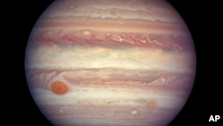 This image from NASA shows Jupiter about 668 million kilometers (415 million miles) from Earth. Jupiter is extra close and extra bright this week, and the Hubble Space Telescope took advantage of the opportunity to make this photo of the gas giant.