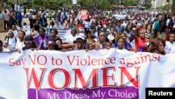 Women take part in a protest, demanding justice for a woman who was attacked and stripped recently in Nairobi by men who claimed that she was dressed indecently, in Nairobi, Kenya, Nov. 17, 2014.