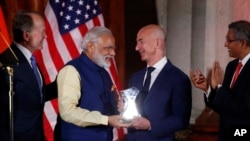 Indian Prime Minister Narendra Modi, second from left presents the Global Leadership Award to Amazon Founder and CEO Jeff Bezos, during the U.S.-India Business Council 41st Annual Leadership Summit, Tuesday, June 7, 2016 in Washington. (AP Photo/Alex Brandon)