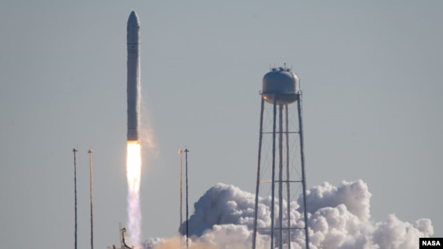 The Antares rocket carrying the Cygnus cargo spacecraft launches from NASA's Wallops Flight Facility in Virginia, Jan. 9. 2014.