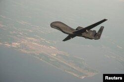 FILE - An Global Hawk drone conducts tests over Maryland in this undated U.S. Navy photo. NATO is purchasing a derivative of the Global Hawk from Northrop Grumman.