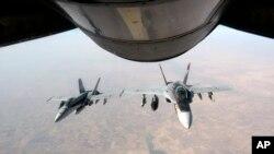 미 공군이 4일 공개한 ISIL에 대한 공습에 나선 미 전투기 모습