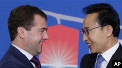 Russian President Dmitry Medvedev, left, and South Korean President Lee Myung-bak shake hands before their press conference in Seoul, South Korea. Medevev is on an official visit to South Korea. Twenty world leaders, including Medvedev, will come togethe