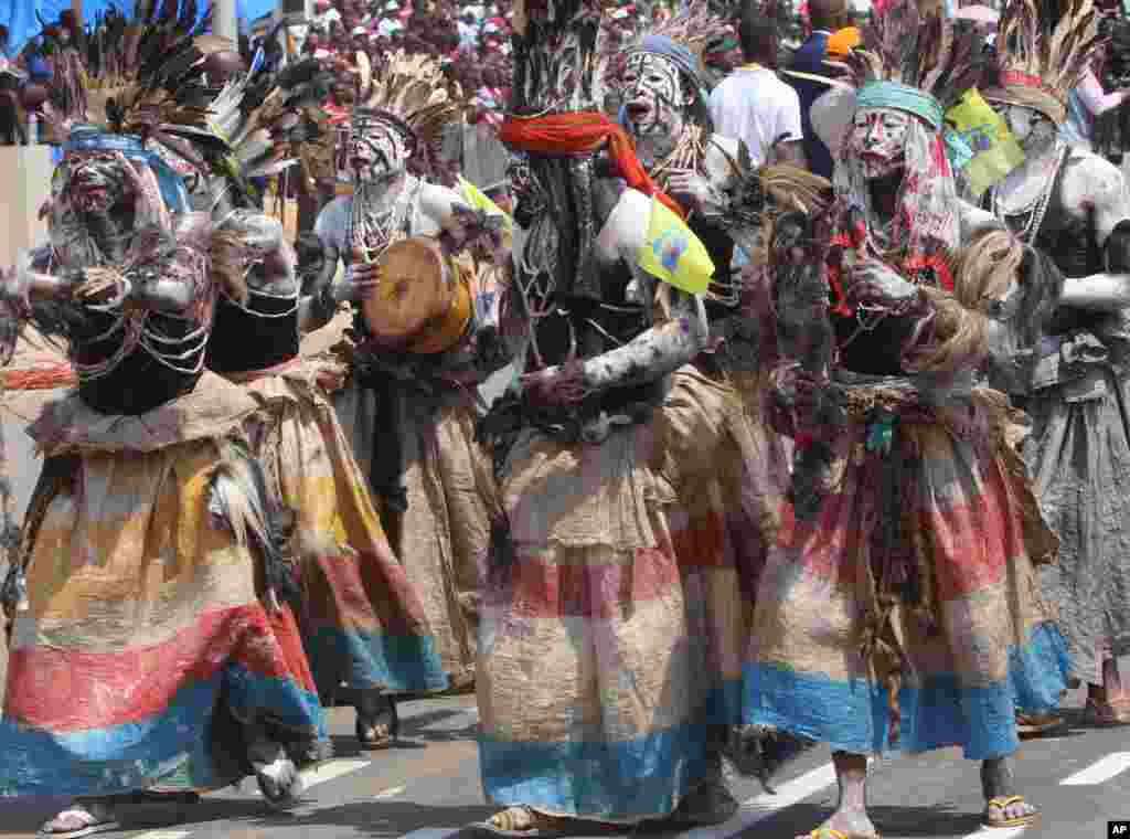 Performers wear traditional gear as people celebrate the Democratic Republic of Congo's independence from Belgium, in Kindu.