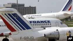 Air France planes are parked at Roissiy-Charles de Gaulle airport, north of Paris.