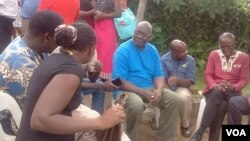 Shimmer Chinodya (in blue top) with other writers at Mungoshi's funeral wake Saturday.