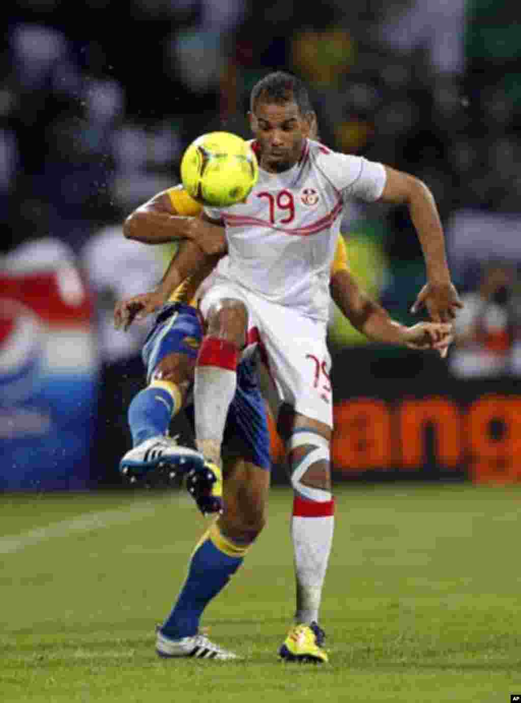 Tunisia's Sabeur Khalifa (front) challenges Lloyd Palun of Gabon during their African Cup of Nations Group C soccer match at Franceville stadium in Gabon January 31, 2012.