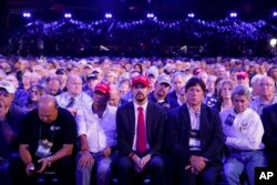 Audience members listen as President Donald Trump speaks at the National Rifle Association Leadership Forum, April 28, 2017, in Atlanta.