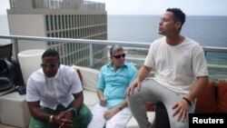 (L-R) Members of the Cuban fusion group Orishas, Yotuel, Roldan and Ruzzo, give an interview from the top of a building in Havana, Cuba, June 22, 2016.