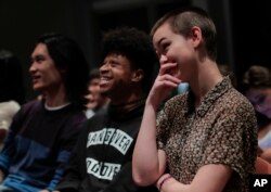 New York University students react while watching the presidential debate between Democratic candidate Hillary Clinton and Republican candidate Donald Trump during a debate watch gathering, Oct. 19, 2016, in New York.