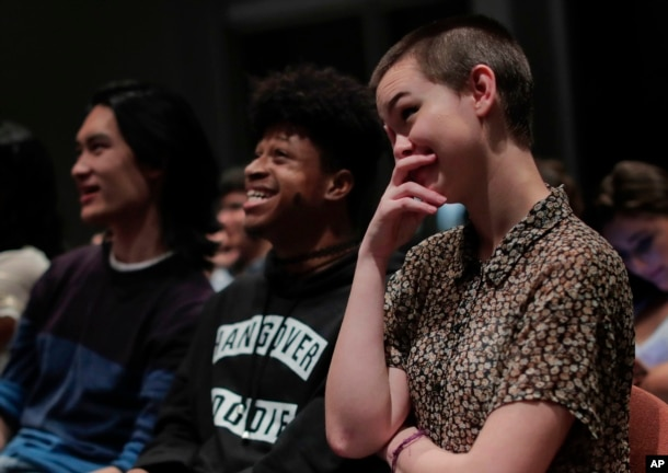 New York University students react while watching the presidential debate between Democratic candidate Hillary Clinton and Republican candidate Donald Trump during a debate watch gathering in New York, Oct. 19, 2016.