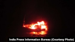 India's Ministry of Defense released this photo that it says shows a Pakistani fishing boat that exploded and burned after those aboard the boat set it on fire after being chased by Indian Coast Guard ships on January 1, 2015.
